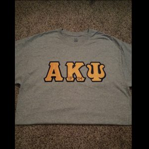 Alpha Kappa Psi Grey Shirt With Gold Letters