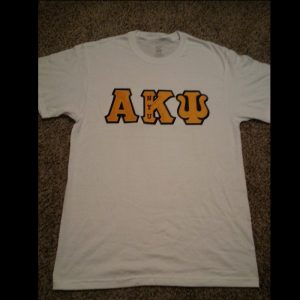 Alpha Kappa Psi White Shirt With Gold Letters
