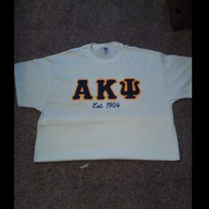 Alpha Kappa Psi White Shirt With Navy/Gold Letters