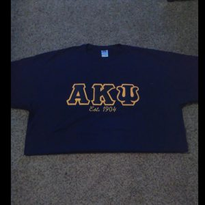 Alpha Kappa Psi Navy Shirt With Navy/Gold Letters