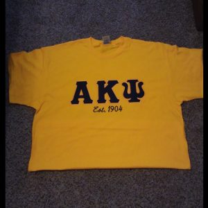 Alpha Kappa Psi Gold Shirt With Navy/Gold Letters