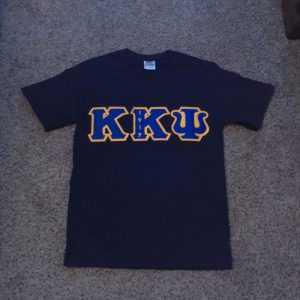 Kappa Kappa Psi Black Shirt with Blue/Gold Letters